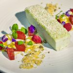 A coconut marshmallow with poached rhubarb, pepita praline and mango pearls