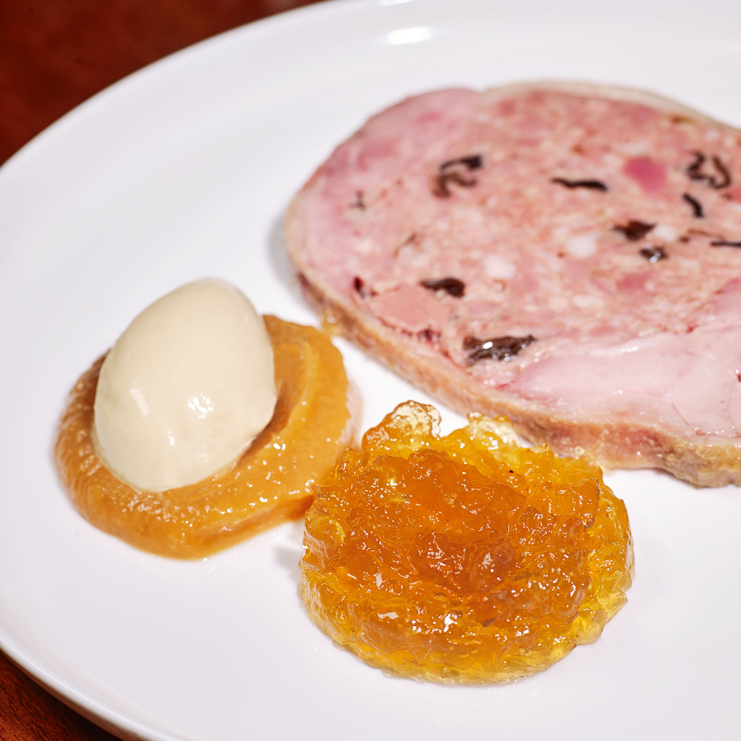 Dodine of duck served (warm), duck aspic, faux foie gras ice cream, spiced French toast, sweet and sour golden raisin purée