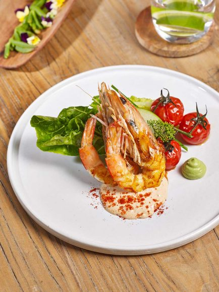 Plated Prawn Cocktail with roasted tomato Marie Rose sauce, avocado cream