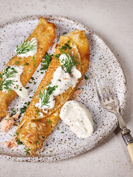 Kefir Crêpes with smoked salmon, pickled onion, sour cream and herbs