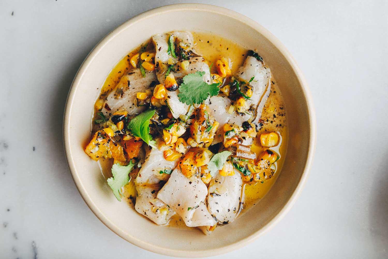 White fish ceviche with charred corn and coriander leaf