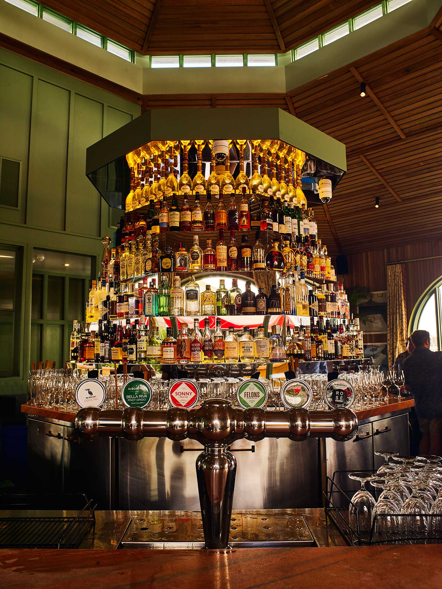 The central cocktail bar at Mr Percival's doubles as a DJ booth, with stairs to the top at its rear.