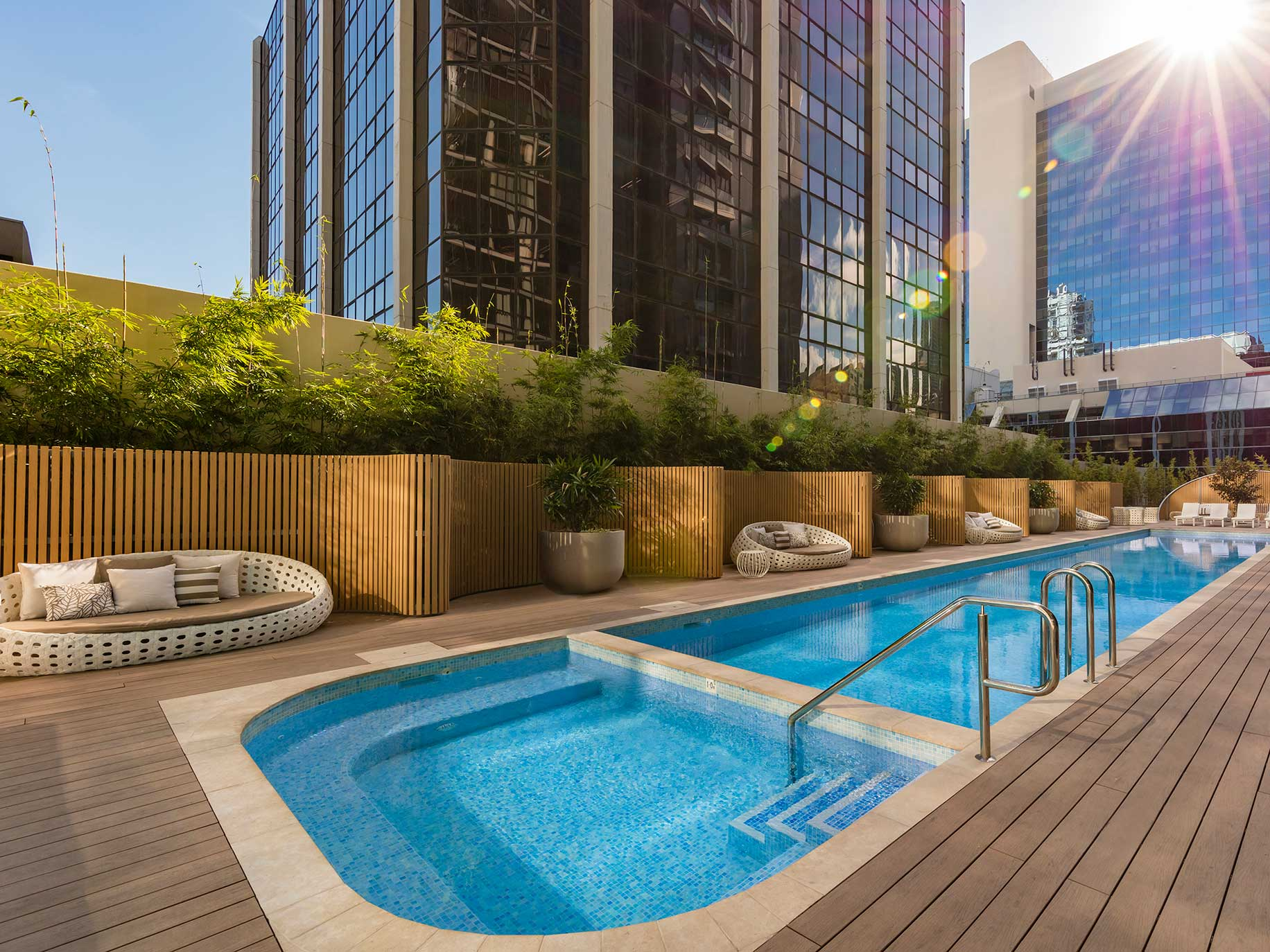 The resort style pool, garden and deck at SKYE Hotel Suites Parramatta