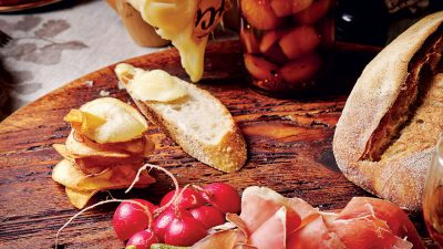 Raclette Cheese with air-dried meats, potato wafers, pickled golden shallots and radishes