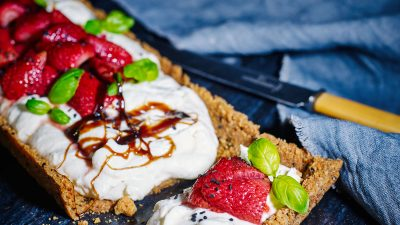 Sesame Ricotta Cheesecake Tart with baked strawberries and sweet balsamic dressing